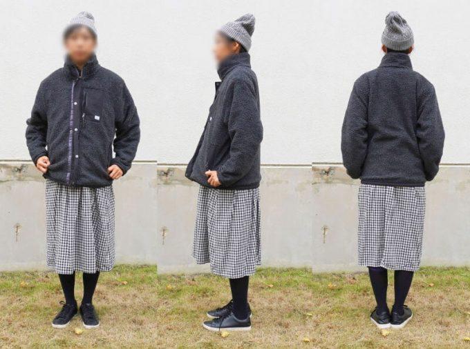 gym master(ジムマスター) リバーシブル マウンテン ジャケットのフリース側を女性がスカートと合わせたコーディネイト