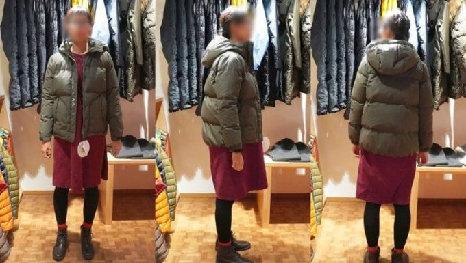 ナンガ 焚き火ダウンジャケット レディースLサイズを女性が着用したサイズ感 (前ジッパーオープン)